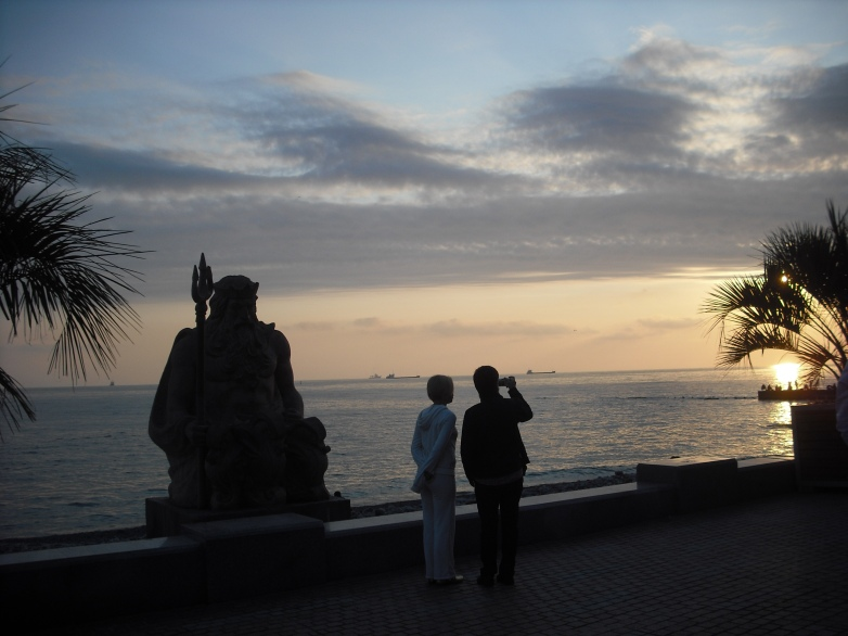 A statue of Neptune overlooking the Sochi boardwalk.